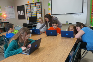 EEI Fifth Graders Learn About the Stock Market Using New Technology