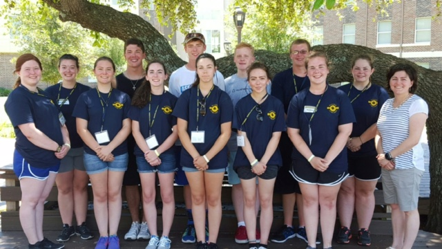 Band Students pose for picture at leadership camp