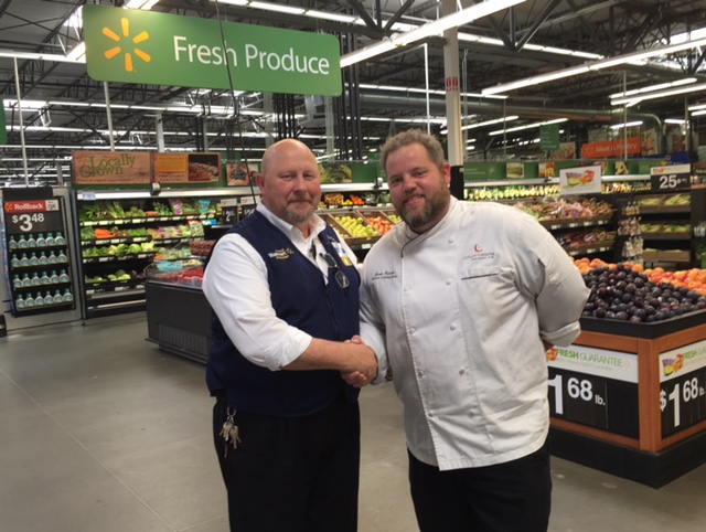 Sheridan food service department representative shakes hands with Walmart representative